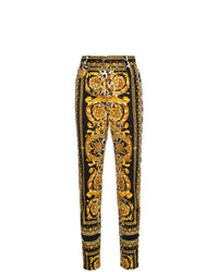 Черные джинсы скинни с принтом от Versace