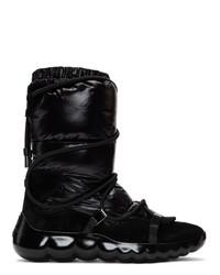 Женские черные зимние ботинки от Moncler