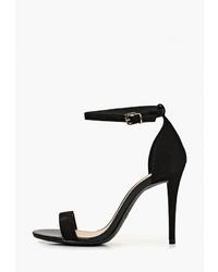 Черные кожаные босоножки на каблуке от Arezzo