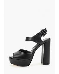 Черные кожаные босоножки на каблуке от Diora.rim