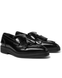 Черные кожаные лоферы с кисточками от Alexander McQueen