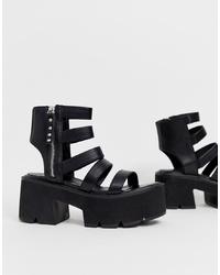 Черные кожаные массивные босоножки на каблуке от Lamoda