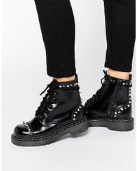 Женские черные кожаные массивные ботильоны на шнуровке от T.U.K.