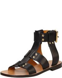 Черные кожаные сандалии на плоской подошве с шипами
