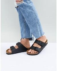 Черные кожаные сандалии на плоской подошве от Birkenstock