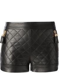 Женские черные кожаные стеганые шорты от Moschino