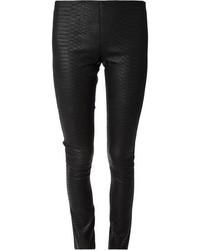 Черные кожаные узкие брюки со змеиным рисунком от Lapis