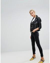 Черные рваные джинсы скинни