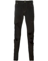 Черные рваные зауженные джинсы