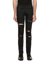Мужские черные рваные зауженные джинсы от Saint Laurent