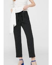 Черные узкие брюки от Mango