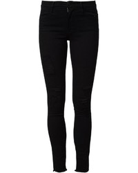 Женские черные хлопковые рваные джинсы скинни от Frame