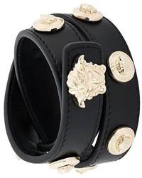 Черный кожаный браслет с шипами от Versace