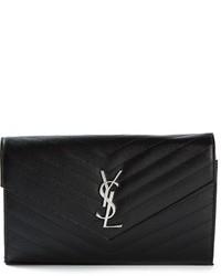 Женский черный кожаный стеганый клатч от Saint Laurent