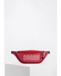 Ярко-розовая кожаная поясная сумка от Coach
