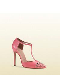 Ярко-розовые кожаные туфли с шипами
