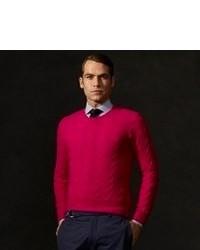 Ярко-розовый вязаный свитер