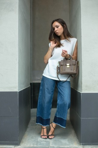 Синие джинсы-клеш от Motivi