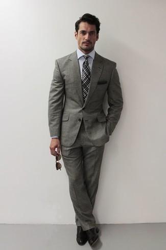 С чем носить темно-серый галстук в шотландскую клетку мужчине: Серый костюм и темно-серый галстук в шотландскую клетку — беспроигрышный образ для светского мероприятия. Такой ансамбль несложно приспособить к повседневным условиям городской жизни, если надеть в тандеме с ним черные кожаные оксфорды.