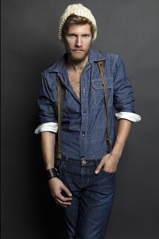 Как и с чем носить: темно-синяя рубашка с длинным рукавом из шамбре, темно-синие джинсы, светло-коричневая шапка, оливковые подтяжки