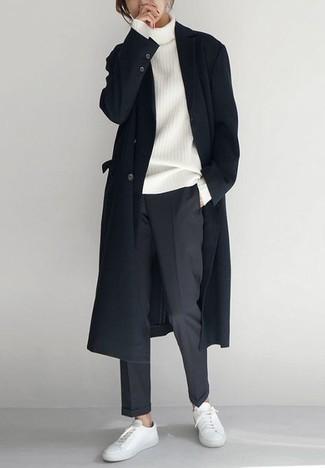Мужские луки: Черное длинное пальто и темно-серые брюки чинос — must have вещи в гардеробе стильного жителя мегаполиса. Ты сможешь легко приспособить такой лук к повседневным нуждам, надев белыми кожаными низкими кедами.